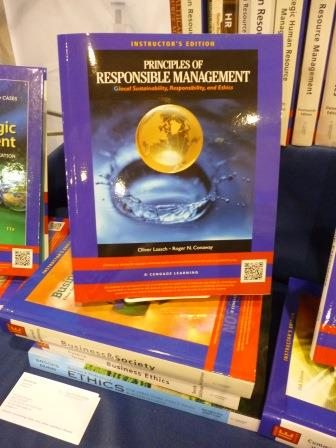 "Caption: ""Principles of Responsible Management Education"" at the Cengage Booth at the Academy of Management Annual Meeting 2014 in Philadelphia"